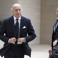 Another distraction: French Foreign Minister Laurent Fabius arrives for a meeting of EU foreign ministers in Luxembourg on Monday. Fabius announced the same day that he had summoned the U.S. ambassador to explain allegations that the U.S. National Security Agency swept up 70.3 million French phone records last December and January | AP