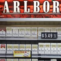 Smoked out: Marlboro cigarette packs are displayed in a Little Rock, Arkansas, on Wednesday. Marlboro's red-and-white box and distinct typeface created one of the world's most powerful brands, but in Australia, the red chevron is now taboo | AP