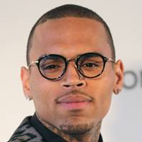 Fight night : U.S. singer Chris Brown arrives for the 21st Annual Elton John AIDS Foundation's Oscar Viewing Party in Hollywood, California, in February. Brown was arrested early Sunday morning and charged with felony assault following an altercation with another man in Washington, D.C   AFP-JIJI