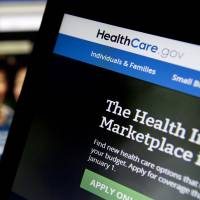 Site difficulties: The <A HREF='http://Healthcare.gov' TARGET='_blank'>Healthcare.gov</A> website is displayed on laptop computers in Washington on Thursday | BLOOMBERG