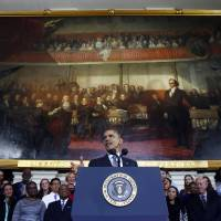 Historic stage: U.S. President Barack Obama speaks at Boston's historic Faneuil Hall about the federal health care law on Wednesday. The venue is where former Massachusetts Republican Gov. Mitt Romney, Obama's rival in the 2012 presidential election, signed the state's landmark health care law in 2006, with top Democrats standing by his side   AP