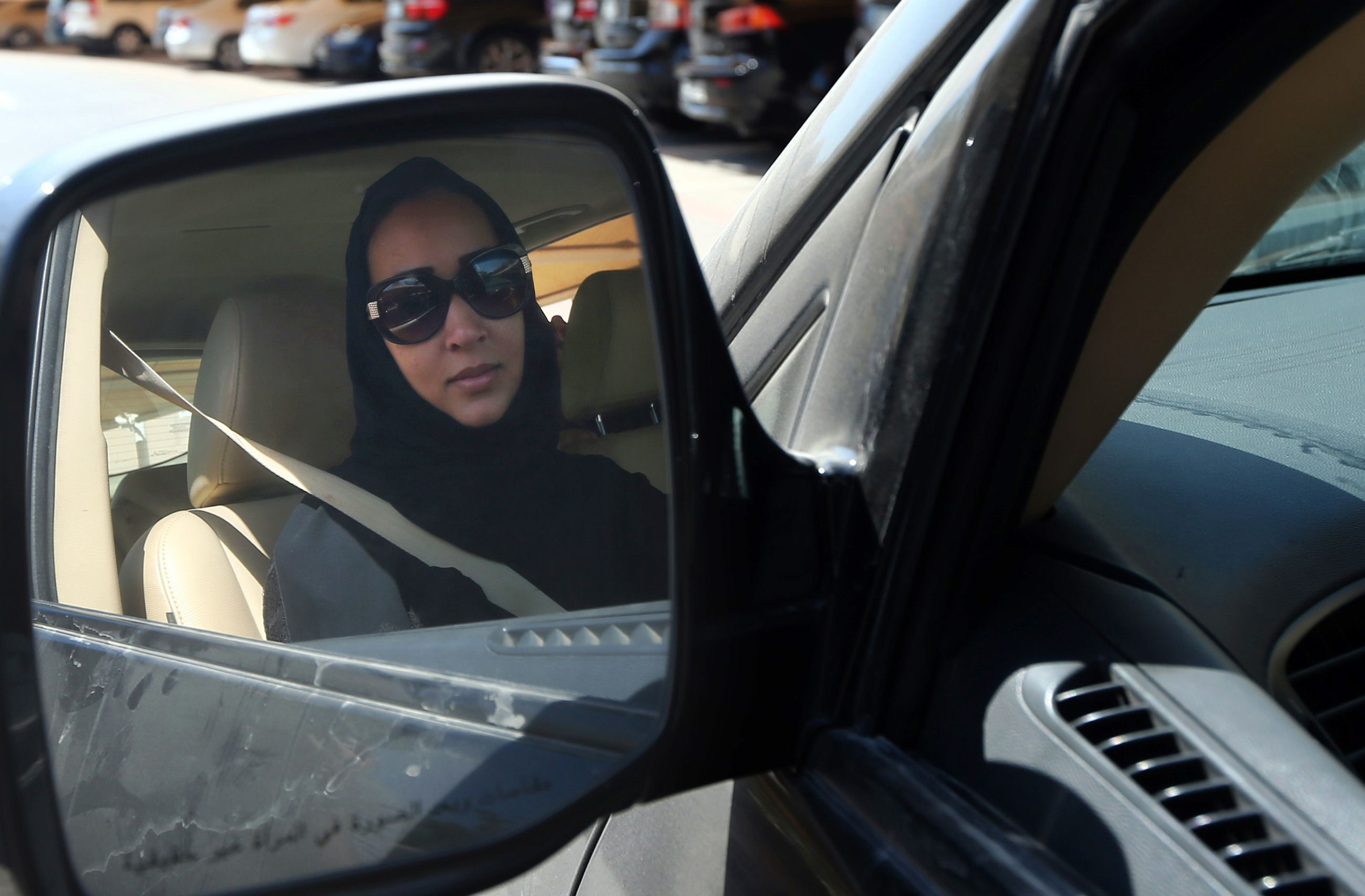 Taking the wheel: Saudi activist Manal al-Sharif, who now lives in Dubai, drives her car in the city Tuesday during a campaign for Saudi women's rights   AFP-JIJI