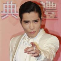 Smash hit: Taiwanese singer Jam Hsiao arrives for the 24th Golden Melody Awards in Taipei on July 6. The singer told reporters Tuesday that two autograph-seekers approached his van on motorcycles and threw a bucket of fecal matter into it. His driver was hit, but Hsai himself was unharmed | AP