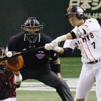 Banner performance: The Giants' Hisayoshi Chono had a 3-for-3 night at the plate with three RBIs in Yomiuri's come-from-behind win in Game 3   KYODO