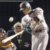 Not enough: The Giants' Takayuki Terauchi belts a solo home run in the eighth inning against the Eagles. It was one of only three hits on the night for Yomiuri | KYODO