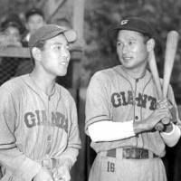 Legend of the game: Tetsuharu Kawakami (right), standing next to ex-Giants teammate Noboru Aota, captured five batting titles during his illustrious 18-year playing career, which ended in 1958. He became the first player in NPB history to reach 2,000 hits and nabbed Central League MVP honors three times | KYODO