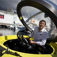 Water world: Erik Hasselman, commercial director of U-Boat  Worx, stands inside a C-Quester 3 submarine during the Monaco Yacht Show on Sept. 25. | BLOOMBERG
