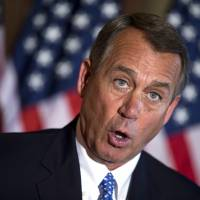 Cross-purposes: Republican House Speaker John Boehner holds a news conference on the ongoing budget battle on Capitol Hill on  Tuesday in  Washington. | AP