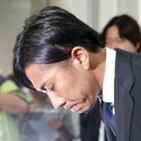 Masakiyo Maezono, the one-time face of Japanese soccer, bows at a news conference after being released by the police Monday. In a drunken rage, Maezono allegedly assaulted a taxi driver Sunday morning. | KYODO