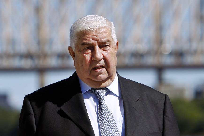 Syria foreign minister likens civil war to 9/11