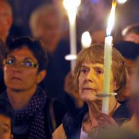 Mourned: People at a rally in Rome on Friday hold candles in memory of the African migrants whose boat sank off the Mediterranean island of Lampedusa early Thursday, killing hundreds of people. | AFP-JIJI