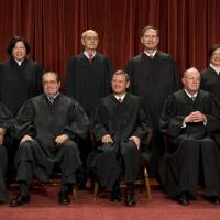The bench: The nine members of the Supreme Court pose for a group photograph to reflect their newest member, Elena Kagan, in October 2010 in Washington. Front row, from left: Clarence Thomas, Antonin Scalia, John Roberts, Anthony Kennedy, Ruth Bader Ginsburg. Back row, from left: Sonia Sotomayor, Stephen Breyer, Samuel Alito, Elena Kagan. | THE WASHINGTON POST