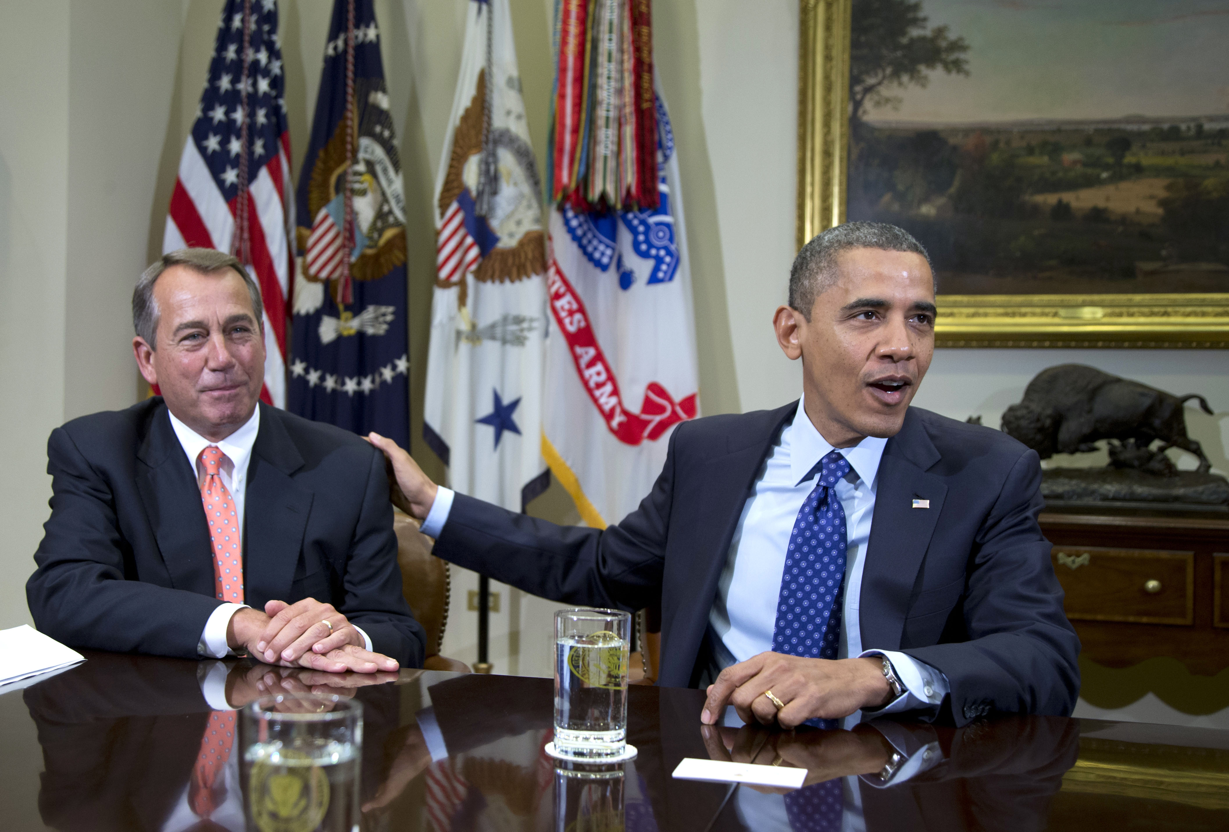 The root of growing animosity between the parties of House Speaker John Boehner (left) and President Barack Obama may be long in the making, scholars say. | AP