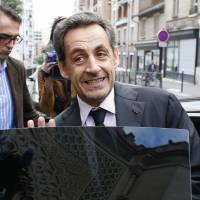 Fewer worries: Former French President Nicolas Sarkozy leaves Paris' Great Mosque after attending a lunch with the rector on Monday, the same day a corruption charge against him was dropped. | AFP-JIJI
