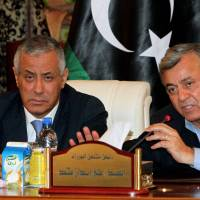 Politics by other means: Libyan Prime Minister Ali Zeidan (left) and Nouri Bousahmein, the head of the General National Congress, give a news conference at government headquarters in  Tripoli on  Thursday after Zeidan was freed from the captivity of militiamen who had held him for several hours. | AFP-JIJI