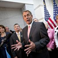 Beltway gridlock: House Speaker John Boehner, joined by fellow Republicans, speaks to reporters on Capitol Hill on Thursday, when he proposed a six-week extension of borrowing authority while budget negotiations progress. | AP