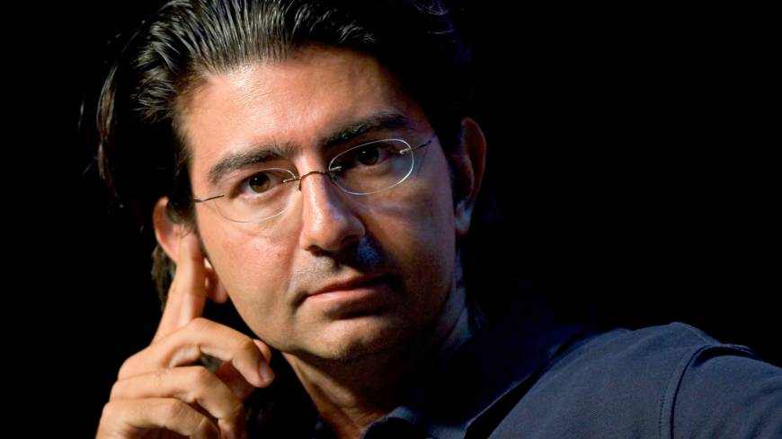 Reporting for duty: Pierre Omidyar, the founder of eBay, listens to a question at the eBay Developer's Conference in Boston in June 2007. Omidyar announced last week a $250 million investment in the most hotly awaited news startup in years. | BLOOMBERG