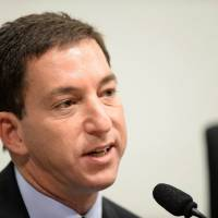 Muckraker: Glenn Greenwald, of The Guardian newspaper, testifies before a Brazilian Senate committee examining charges of espionage by the U.S. in Brasilia on Oct. 9. Greenwald announced Wednesday that he is leaving the British daily to work on a new news venture backed by eBay's billionaire founder, Pierre Omidyar. | AFP-JIJI