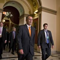 Walk on by: Republican Speaker of the House John Boehner walks to the chamber to vote on a bill to reopen the U.S. government and avert a threatened Treasury default at the Capitol in Washington on Wednesday, after a partial 16-day federal shutdown. | AP