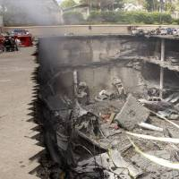 Shattered: The collapsed car parking area of the Westgate Mall in Nairobi is seen Sept. 26. The mall was attacked Sept. 21 by Islamist rebels. | AP