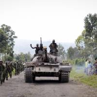 Upper hand: Congo Army soldiers are cheered by residents of Rugare on Monday after they forced M23 rebels out of the town over weekend. | AP