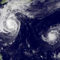 Double trouble: Typhoons 27 and 28 heading up to Japan (at top) on Oct. 23. | AFP-JIJI