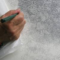 A close-up of Hiroyuki Doi at work on a new drawing in his studio in Tokyo recently.   EDWARD M. GOMEZ