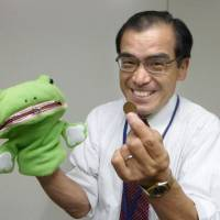 Bringing out the big guns: An Ishikawa Prefectural Police officer uses ventriloquism in a class aimed at teaching the elderly about the dangers of remittance scams last month. Despite years of imaginative awareness campaigns, the ore-ore scam is still finding gullible victims. | KYODO