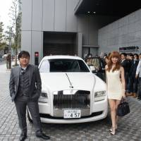 Tips for the top: Millionaire Tsubasa Yozawa (left)  offers these 'keys to success' for budding fellow tycoons: 'Pride is something you don't need' and 'Believe you're a genius!'   COURTESY OF YOZAWA TSUBASA MATOME