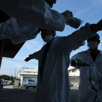 Next nightmare: A worker is screened for radiation in Minamisoma after leaving the 20-km exclusion zone around the wrecked Fukushima No. 1 nuclear power plant in September 2011.   BLOOMBERG