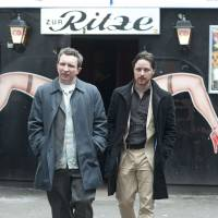 Protect and serve yourself: James McAvoy (right) plays a bent cop who goes spectacularly off the rails in 'Filth.' | © 2013 LITHIUM PICTURE LIMITED