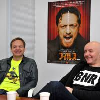 Left: Director Jon S. Baird (left) and author Irvine Welsh on a promotional visit to Tokyo this week. | YOSHIAKI MIURA