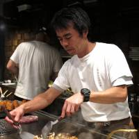 Fry guy: A chef tends the teppan grill at Misotetsu Kagiroi. The restaurant also makes its own selection of miso dips. | ROBBIE SWINNERTON