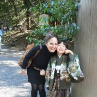 New challenge: Leza Lowitz visits  Tokyo's Meiji Jingu Shrine with her son, whom she adopted five years ago. | COURTESY OF LEZA LOWITZ