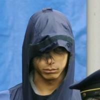 Ichihashi is transferred between police stations after his capture in July 2011. | KYODO