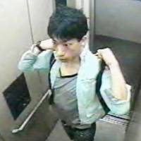 Chasing a killer: Chiba prefectural police released in May 2007 an image of Tatsuya Ichihashi standing in an elevator. | KYODO