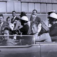 Dark day: U.S. President John F. Kennedy rides in a motorcade shortly before he was shot in Dallas on Nov. 22, 1963. | AP