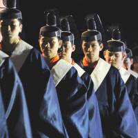 Shinto priests take part in the same ceremony. | KYODO