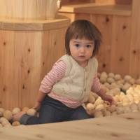 Natural high: The writer's daughter surrounded by aromatic wooden balls in the Toy Wood Forest at Tokyo Toy Museum. | DANIELLE DEMETRIOU