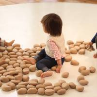 Hands on: Handcrafted wooden pebbles in the Wood Education Baby Room. | DANIELLE DEMETRIO