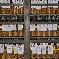 Liquid assets: Bottles of aging dai-ginjo , the top grade of sake at the Ozawa Brewery. | STEPHEN MANSFIELD PHOTO