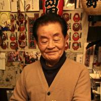 Yasushi Ogawa holds a tamuningyo (paper mache figurine), made to welcome in 2014, the Year of the Horse.   PHOTO KIT NAGAMURA