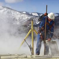 On tap: A worker checks water levels and temperatures in tanks at an Encana Oil & Gas hydraulic fracturing operation at a gas drilling site outside Rifle, Colorado, on March 29. | AP