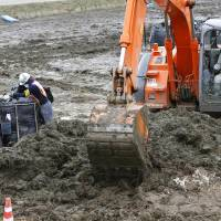 Funded by you: Decontamination work continues in Kawamata, Fukushima Prefecture, on Thursday. The government is planning to use in excess of ¥1 trillion in public funds for efforts to clean up contaminated areas around the wrecked Fukushima No. 1 nuclear plant. | KYODO
