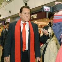 Go North: Pro wrestler-turned-Upper House lawmaker Antonio Inoki of opposition party Nippon Ishin no Kai (Japan Restoration Party) walk toward the departure gate at Beijing international airport to catch a flight to North Korea on Saturday. | KYODO