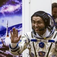 National treasure: Astronaut Koichi Wakata, a crew member of the latest mission to the International Space Station, readies for liftoff at Baikonur, Kazakhstan, on Thursday. | AP