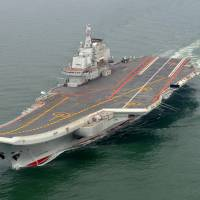 Ramping up: The Chinese aircraft carrier Liaoning, seen in May 2012, left Qingdao port Tuesday for the South China Sea. | AP