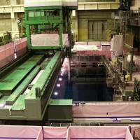 High degree of difficulty: The spent-fuel storage pool is seen inside the reactor 4 building at Tokyo Electric Power Co.'s Fukushima No. 1 plant in July | BLOOMBERG