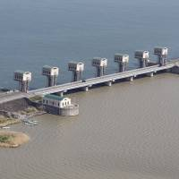 Environmental impact statement: The floodgates in the Isahaya Bay dike in Nagasaki Prefecture are seen in April. The Nagasaki District Court issued an injunction Tuesday barring the government from opening the gates   KYODO