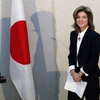 Step to the East: New U.S. Ambassador Caroline Kennedy smiles after arriving at Narita International Airport, east of Tokyo, on Friday | AFP-JIJI